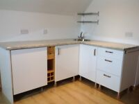 Kitchen units with integrated fridge, worktops sink and tap