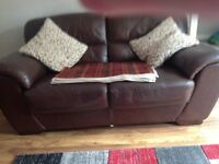 A sturdy clean large 2 seater chocolate leather sofa. Great condition. .