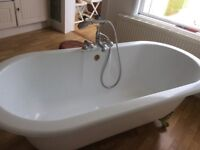 Roll Topped Bath complete with taps. A couple of marks. 4 claw feet