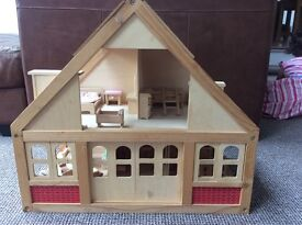Wooden dolls house, furniture and figures