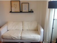 IKEA Karlstad 2 seater white sofa ( no covers)