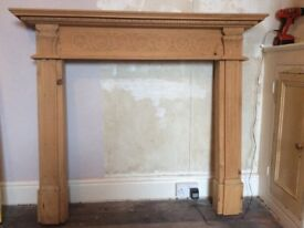 Ornate and beautifully carved wooden fireplace surround