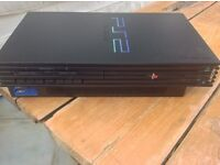 Playstation 2 with controller and selection of games