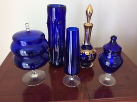 Decorative blue glass vases and ornaments.