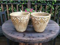 Two heavy pots