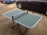 Folding table tennis table with net