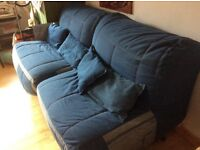 Two denim chairs that fold to single beds