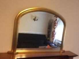 Over mantle mirror.