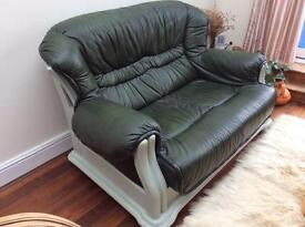 Two-seater leather sofa with solid painted wooden frame.