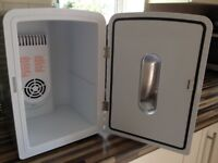 Portable refrigerator with carrying handle