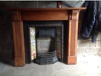 Cast iron fireplace with pine surround