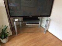 Large glass tv stand, holds 50 inch flat screen tv,, 104cm wide,, 54cm height,,46cms depth,