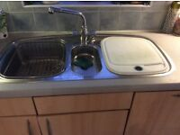 A franke second hand sink with mixer taps.