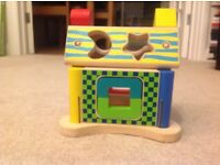 Hamleys wooden house puzzle
