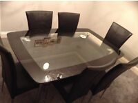 Black & clear glass dining table & 6 chairs