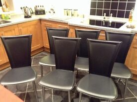 Six Black Faux Leather Chairs