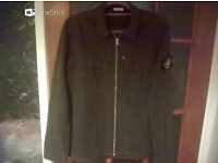 Medium charcoal Stone Island jacket.Real no copy very nice only been worn several times out.