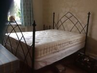 Metal bed with matching bedside tables plus mattress.