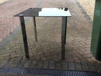 Table and 4 chairs, 80cm square, black glass topped.