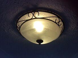 Circular bronze effect light fitting