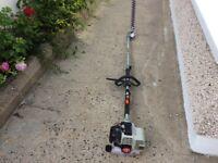 Gardencare GC262CH Petrol long reach hedge strimmer Push button start. 55cm blade 2.2 meter reach.p.