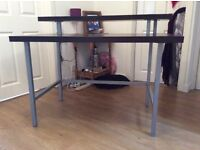 Dark wood desk with two tiers and metal frame