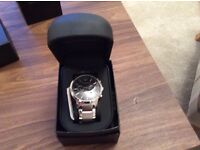 Brand new silver Armani Watch, unwanted Christmas present. Unworn and extra links in box.