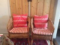 A pair of cane chairs
