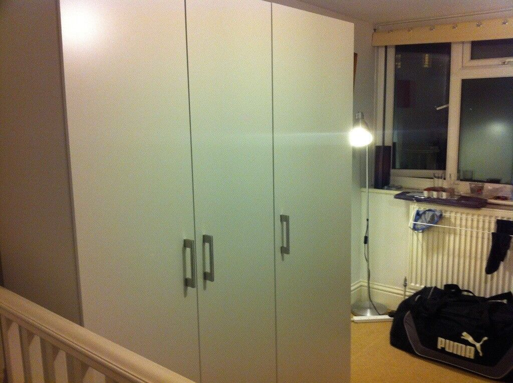 White IKEA 3 door wardrobe