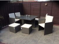 9 piece Rattan effect cube is in top condition, it has the table, 4 chairs & 4 stools with cover