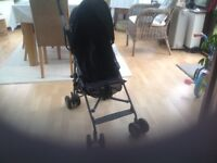 John Lewis all black buggy with shopping net underneath