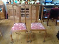 Carved oak chairs x 2
