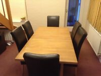 Solid Wood Dining Table and FREE Chairs.