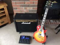 Marshall amp and Vintage Les Paul with multi effects pedal.