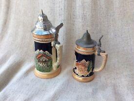 Two German decorative beer steins