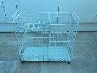 White wire vegetables rack with tray.