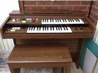 Electric Yamaha organ including stool