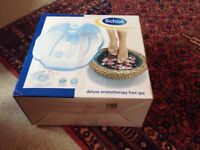 Scholl foot spa, brand new in the box, never been out of it. Massaging aromatherapy features.