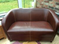 Leather two seater sofa and armchair