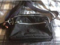 Kipling shoulder bag in black very good condition hold keys purse phone and mini iPad