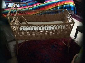 Whicker crib on legs for new born to three months. Good condition. With mattress