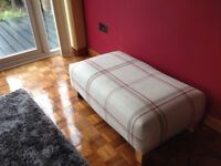 Large footstool in Laura Ashley cranberry loxley check