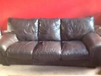 Brown three seater leather sofa