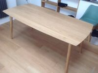 Nearly new oak/veneer dining table. Sits 6.