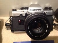 Olympus OM 10 SLR Camera, complete with lenses, flash and manuels