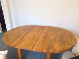 Round dining table and 4 chairs. Solid wood. 110cm diameter. When extended 160 X 110cm.