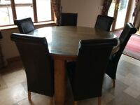 Round table and six brown chairs