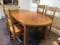 Large oak dining table and chairs - seats 6, 8-10 when extended