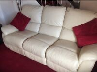 Manually operated 3 seater sofa with electrically operated chair in cream leather
