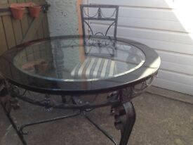 Lovely glass table with four regency stripe chairs almost new